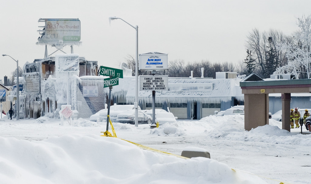 Image of roads and buildings covered with snow.